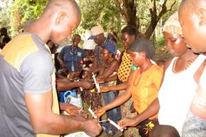 The Water Project: Kolia Community -  Building Handwashing Stations