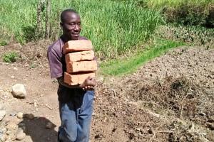 The Water Project: Ataku Community, Ataku Spring -  Carrying Bricks To The Spring