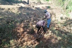 The Water Project: Ataku Community, Ataku Spring -  Digging Drainage