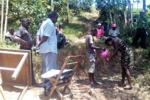 The Water Project: Maganyi Community, Bebei Spring -  Handwashing Training