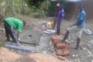 The Water Project: Musango Community, Dawi Spring -  Sanitation Platform Construction