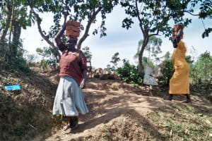 The Water Project: Ataku Community, Ataku Spring -  Carrying Bricks