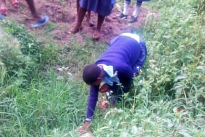 The Water Project: Shiru Primary School -  A Student Stops At A Puddle Of Water
