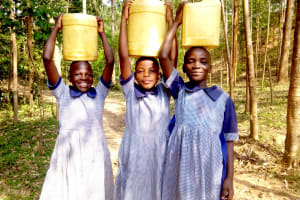 The Water Project: Imuliru Primary School -  Carrying Water