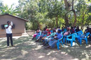 The Water Project: Bukhunyilu Community, Solomon Wangula Spring -  Solar Disinfection Training