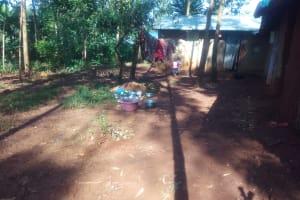The Water Project: Shirakala Community, Ambani Spring -  Kenya Dishes Drying As Children Play