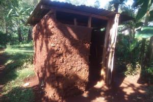 The Water Project: Shirakala Community, Ambani Spring -  Kenya Latrine With Mud Walls And Metal Roof