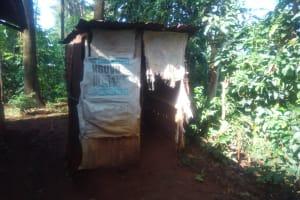 The Water Project: Shirakala Community, Ambani Spring -  Kenya Sample Latrine With Sacks As Doors
