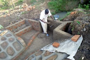 The Water Project: Musango Community, M'muse Spring -  Cementing Protected Spring