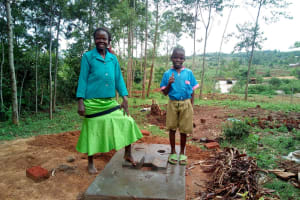 The Water Project: Musango Community, M'muse Spring -  Standing With New Latrine Platform