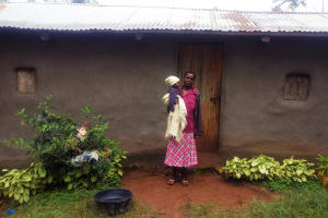 The Water Project: Emulakha Community, Alukoye Spring -  Woman And Child Infront Of Home
