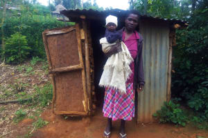 The Water Project: Emulakha Community, Alukoye Spring -  Woman Stands With Her Child