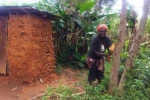 The Water Project: Emulakha Community, Alukoye Spring -  Woman Uses Improvized Handwashing Station