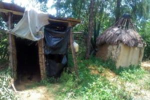 The Water Project: Handidi Community, Chisembe Spring -  Sample Latrine