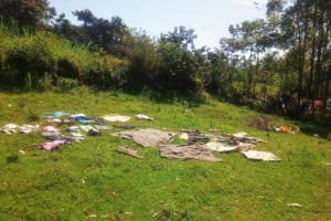 The Water Project:  Drying Cloths On The Ground
