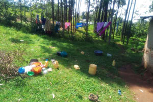 The Water Project:  Water Containers Scattered At A Compound In The Community