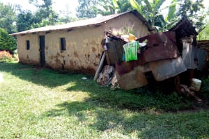 The Water Project: Irumbi Community, Okang'a Spring -  A Household With A Bathroom Made Of Old Sheets Beside It
