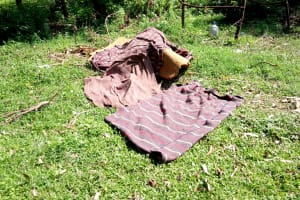 The Water Project: Irumbi Community, Okang'a Spring -  Bedding Left To Dry On The Ground