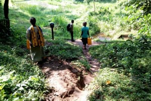 The Water Project: Irumbi Community, Okang'a Spring -  People Walk Down To Spring