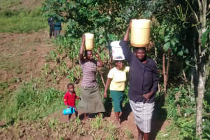 The Water Project: Musiachi Community, Thomas Spring -  Carrying Water From The Spring