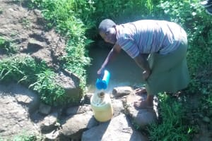 The Water Project: Musiachi Community, Thomas Spring -  Fetching Water At Thomas Spring