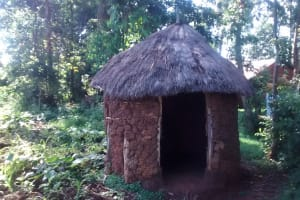 The Water Project: Musiachi Community, Thomas Spring -  Grass Thatched Roof Latrine