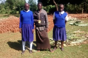 The Water Project: Musiachi Community, Thomas Spring -  Mrs Indole With Her Girls At Their Compound