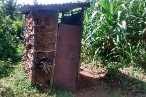 The Water Project: Musiachi Community, Thomas Spring -  Mud Latrine With Door