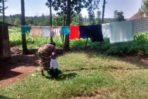 The Water Project: Musiachi Community, Thomas Spring -  Washing And Hanging Clothes
