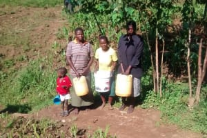 The Water Project: Musiachi Community, Thomas Spring -  Women And Girls Stand With Water Containers
