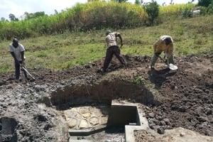 The Water Project: Futsi Fuvili Community, Simeon Shimaka Spring -  Clearing Ground Around Spring