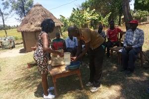The Water Project: Futsi Fuvili Community, Simeon Shimaka Spring -  Handwashing At Community Training