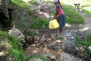 The Water Project: Indete Community, Udi Spring -  A Community Member Gets Fready To Fetch Water