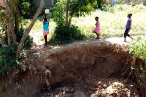 The Water Project: Indete Community, Udi Spring -  Bringing Water Home From Spring