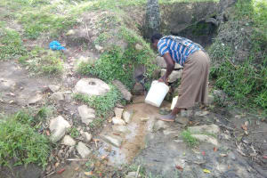 The Water Project: Indete Community, Udi Spring -  Fetching Water