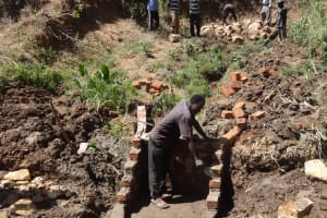 The Water Project: Elukuto Community, Isa Spring -  Laying Bricks For Protection