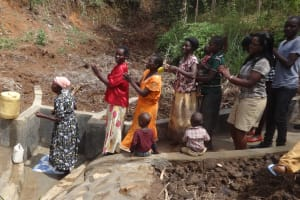 The Water Project: Elukuto Community, Isa Spring -  Lined Up For The Clean Water
