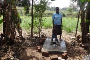The Water Project: Elukuto Community, Isa Spring -  Standing With New Latrine Platform