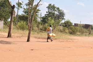 The Water Project: Wee Primary School -  Carrying Buckets To Collect Water