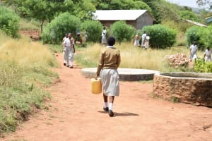 The Water Project: Kithoni Secondary School -  Girl Carries Jerrycan Of Water