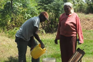 The Water Project: Vilongo Community -  Vilongo Woman Carrying Water
