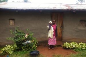 The Water Project: Emulakha Community, Alukoye Spring -  Mama Karani Outside Her House