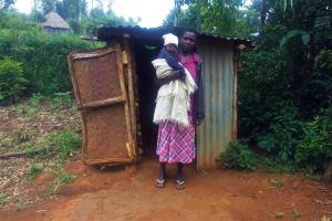 The Water Project: Emulakha Community, Alukoye Spring -  Mama Karani Outside Her Latrine