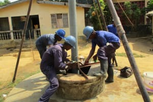 The Water Project: Tholmosor Community, Alpha Dabola Road -  Installation Of Casing Pipes