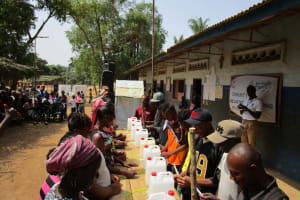 The Water Project: Tholmosor Community, Alpha Dabola Road -  Learning To Construct Handwashing Stations For Home