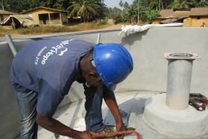 The Water Project: Tholmosor Community, Alpha Dabola Road -  Preparing Pump For Installation