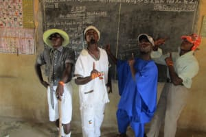 The Water Project: Tholmosor Community, Alpha Dabola Road -  Training Acting Troupe