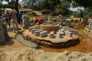 The Water Project: Tholmosor Community, Alpha Dabola Road -  Well Pad Construction And Bricking