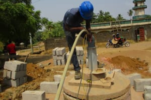 The Water Project: Tholmosor Community, Alpha Dabola Road -  Flushing The Well