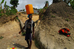 The Water Project: Kasongha Community, Kombrai Road -  Carrying Water